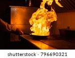 flambe lamb rib roast. cooking... | Shutterstock . vector #796690321