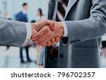 close up of businessmen shaking ... | Shutterstock . vector #796702357
