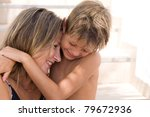 happy son hugs his mather | Shutterstock . vector #79672936