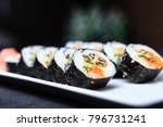 seashell roll on a plate with... | Shutterstock . vector #796731241