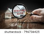 hand holding magnifying glass... | Shutterstock . vector #796736425