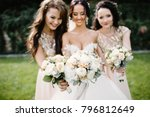 laughing bride and bridesmaids... | Shutterstock . vector #796812649