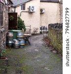 Small photo of Beer kegs in alleyway