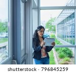 smiling businesswoman with... | Shutterstock . vector #796845259