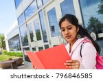 student with notebook next to... | Shutterstock . vector #796846585