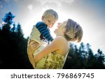 little blond boy rejoices on... | Shutterstock . vector #796869745