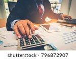 a businessman analyzing... | Shutterstock . vector #796872907