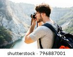 caucasian man taking photo | Shutterstock . vector #796887001