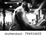 people exercising at fitness gym | Shutterstock . vector #796914655