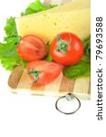 Arrangement with tomatoes and cheese on Cutting board - stock photo