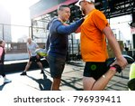 people exercising at fitness gym | Shutterstock . vector #796939411