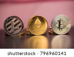 Small photo of Bitcoin. Ethereal. Litecoin. Golden cryptocurrencies at All-Time