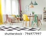 pink armchair next to a beige... | Shutterstock . vector #796977997