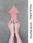 feet on the pink arrow drawn... | Shutterstock . vector #796979794