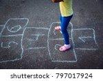 Little Girl Playing Hopscotch...