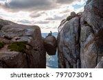 woman on kjeragbolten travel in ... | Shutterstock . vector #797073091