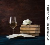 Small photo of Books Are Knitted by the Jigut Rope, Rosebud, Glass with Wine and the Open Book.