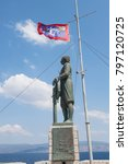 Small photo of A monument for andras Miaoulis at the harbour of the Aegean island of Hydra, Greece