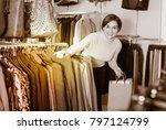 laughing woman choosing...   Shutterstock . vector #797124799