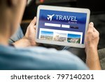 Small photo of Man searching cheap flights, hotel or holiday package on internet by using online travel search application with tablet. Ordering holiday and making reservation on website with smart device.