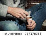 Small photo of Hands addict. Drugs and the concept of crime.