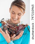 smiling woman holding a pile of ... | Shutterstock . vector #797210965