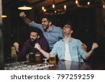 men at the pub watching game... | Shutterstock . vector #797259259