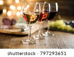 Stock photo three glass of red wine rose wine and white wine with french cheese and delicatessen in restaurant 797293651