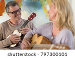 couple playing guitar and... | Shutterstock . vector #797300101