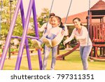 at the park  parents are... | Shutterstock . vector #797311351