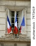 French national flags at a town hall - stock photo