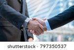 businessmen making handshake... | Shutterstock . vector #797350537