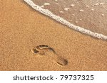 Footprint In Golden Sand On Th...