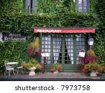 Front of a French restaurant with menu boards - stock photo
