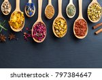 herbs on spoons on a wooden... | Shutterstock . vector #797384647