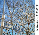 a snowy main street sign in... | Shutterstock . vector #797389291