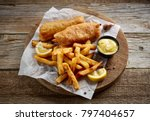 fish and chips on wooden table | Shutterstock . vector #797404657