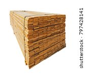 Small photo of Stacked lumber. Folded wood. Boards in the warehouse. Isolated. Perspective.