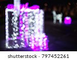 Small photo of Bokeh lighting background from light blue, purple, white, with blurred and ultraviolet bokeh shaped like a gift box, perfect for Christmas or New Year accompanying festivals.