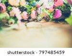 flowers on wooden background... | Shutterstock . vector #797485459
