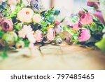 flowers on wooden background... | Shutterstock . vector #797485465