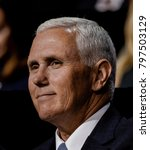 Small photo of Cleveland Ohio, USA, 18th July, 2016 Republican Governor and now VIce-Presidential candidate Michael Pence sits with the Trump family during the Republican National Convention in the Quicken Arena.