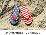 Pair Of Flip Flop On Sand Of...