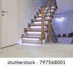 Bright interior with oak ladder with LED backlighting - stock photo