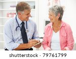 doctor with female patient | Shutterstock . vector #79761799