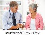 doctor with female patient | Shutterstock . vector #79761799