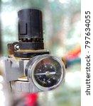Small photo of Air pressure gauge in work area.