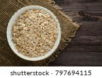 oatmeal on a wooden table.... | Shutterstock . vector #797694115