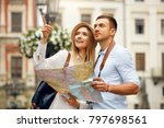 couple with map on travel... | Shutterstock . vector #797698561