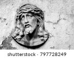 Small photo of Face of Jesus Christ on old tombstone. Black and white image